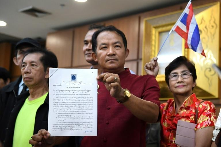 Srisuwan Janya from a royalist activist group called on the Thai Raksa Chart leader to resign