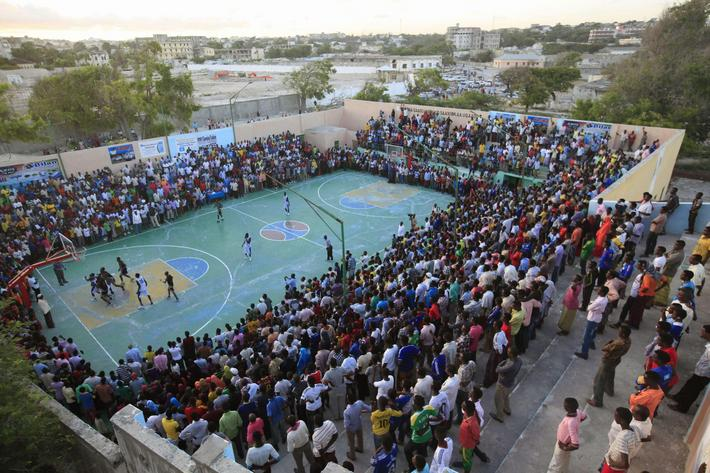 Basketball fans gather at Lujino stadium as they watch the final between Hegan and Horseed in Mogadi