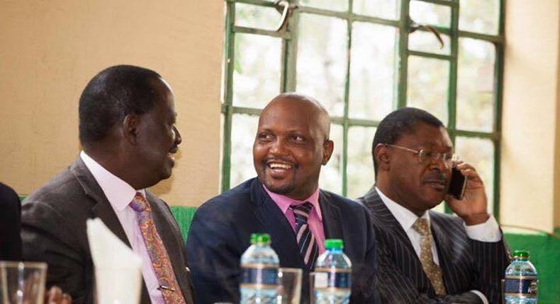 Gatundu South MP Moses Kuria with Opposition leader Raila Odinga