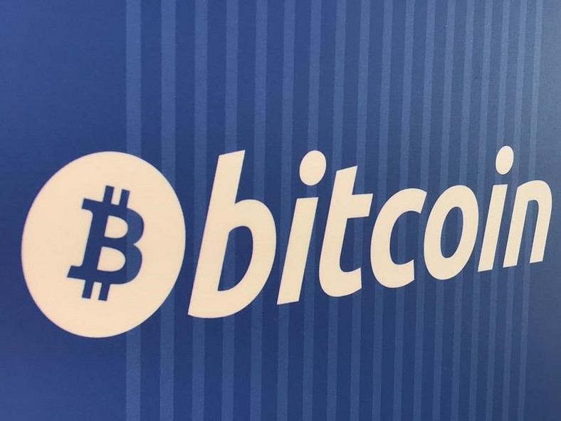 A Bitcoin logo is seen on a cryptocurrency ATM in Santa Monica