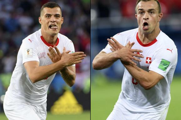 Granit Džaka i Đerdan Šaćiri slave golove na meču sa Srbijom