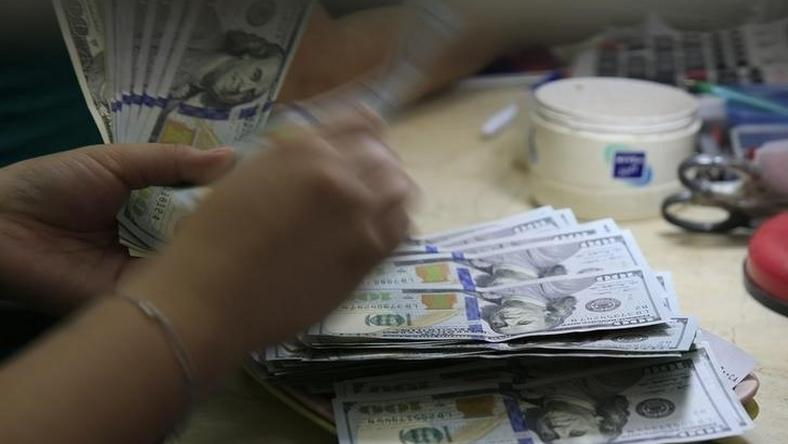 A Worker Counts U S 100 Dollar Banknotes Inside Money Changer In Manila Philippines