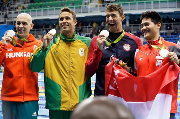 Čeh, Le Klos, Felps i Skuling sa medaljama