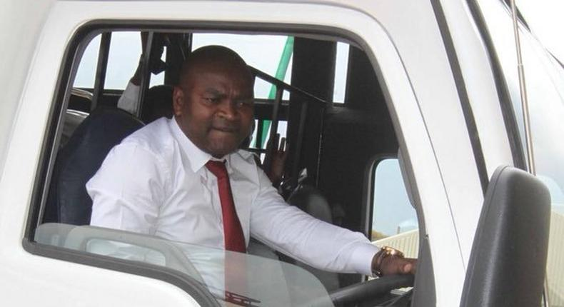 Former Sports CS Rashid Echesa during a past  commissioning of a bus (Twitter)