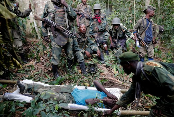 The Wider Image: Charred bodies, wounded soldiers after Congo army victory