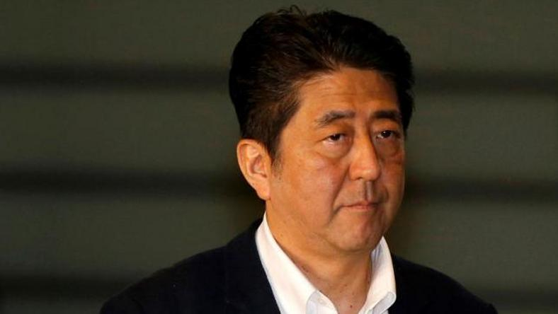 Japan PM Abe urges BOJ to ensure market liquidity after Brexit vote
