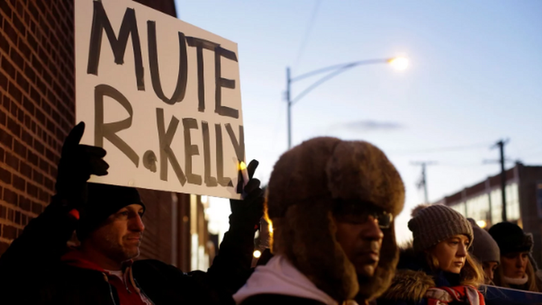 Many protesters positioned themselves in front of Sony Music's New York City headquarters on Wednesday to ask the label to drop R. Kelly. [Joshua Lott/Reuters]