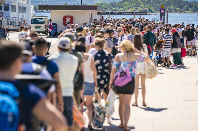 Turisti u Oslu u maju