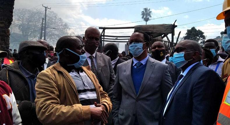 Interior PS Karanja Kibicho with traders from Gikomba Market hours after inferno destroyed goods of unknown value on June 25, 2020