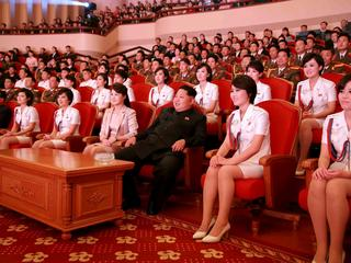 FILE PHOTO: North Korean leader Kim Jong Un and wife Ri Sol Ju enjoy an art performance given by the