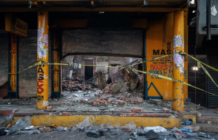 The scene of a looted shop where a charred body was found in Johannesburg on September 4, 2019 [Michele Spatari/AFP/Getty Images]