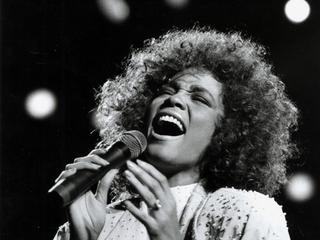 Singer Whitney Houston performing in 1986