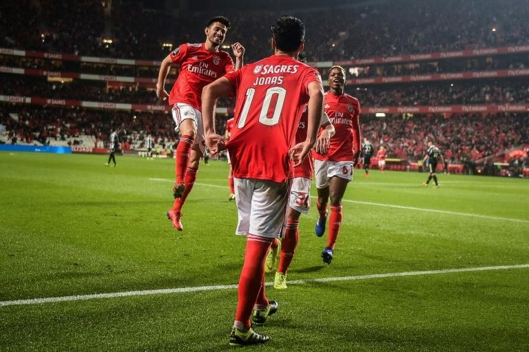 Double digits: Jonas rounds out the scoring as Benfica humiliate Nacional