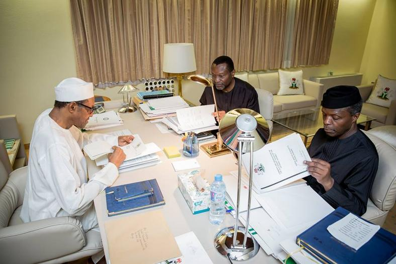 Udoma Udo Udoma meeting President Buhari and Yemi Osinbajo to scrutinize the 2016 budget