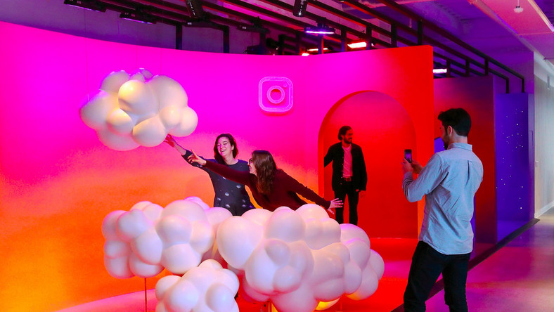 People pose for a photo inside Instagram's headquarters.