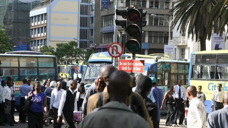 Kenyans on a busy Nairobi street. Mobile loan app services have come up with a new strategy to compel defaulters to pay up their loans