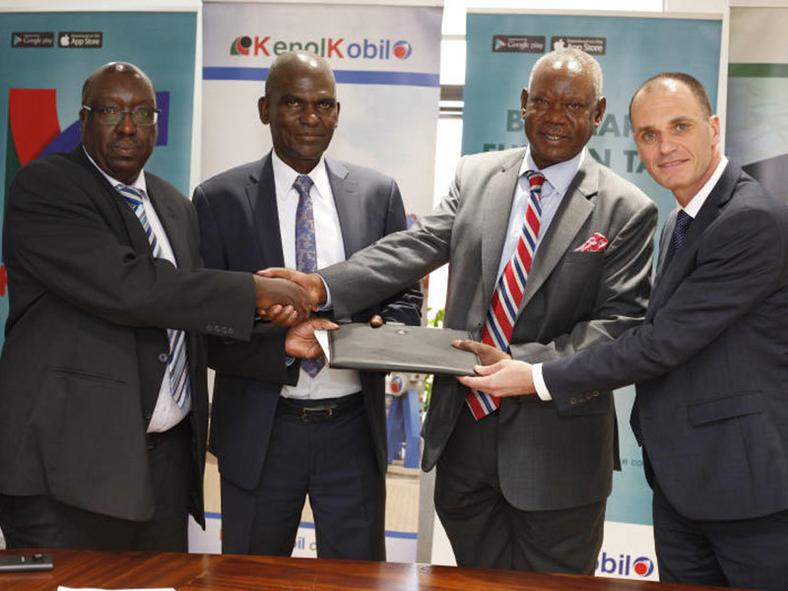 KenolKobil Plc MD Mr. David Ohana, (Right), KenolKobil Chairman, Mr. James Mathenge, Eric Karambasaizi Group MD Delta Rwanda &Uganda, Joseph Gitau Mburu, Director Delta Rwanda & Uganda during the sign off ceremony that saw KenolKobil acquire 33 Delta fuel stations in Uganda and Rwanda.
