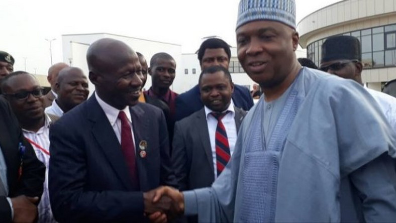 Senate President Bukola Saraki pumps fists with EFCC boss Ibrahim Magu. The senate has refused to confirm Magu as substantive EFCC Chairman