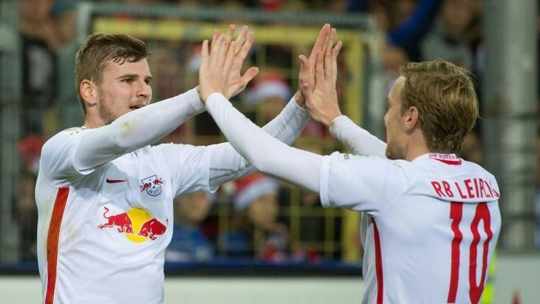 Leipzig's forward Timo Werner (L) celebrates with teammate forward Emil Forsberg after he scored during the German first division Bundesliga football match against SC Freiburg November 25, 2016
