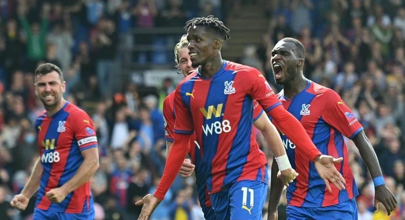 Crystal Palace's Wilfried Zaha (C) celebrates scoring against Tottenham Creator: JUSTIN TALLIS