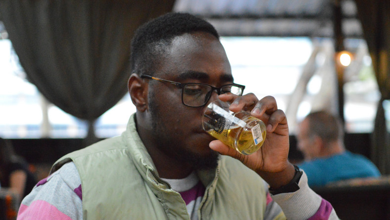 A beer lover down a glass of beer at Nairobi Beer Festival. (George Tubei)