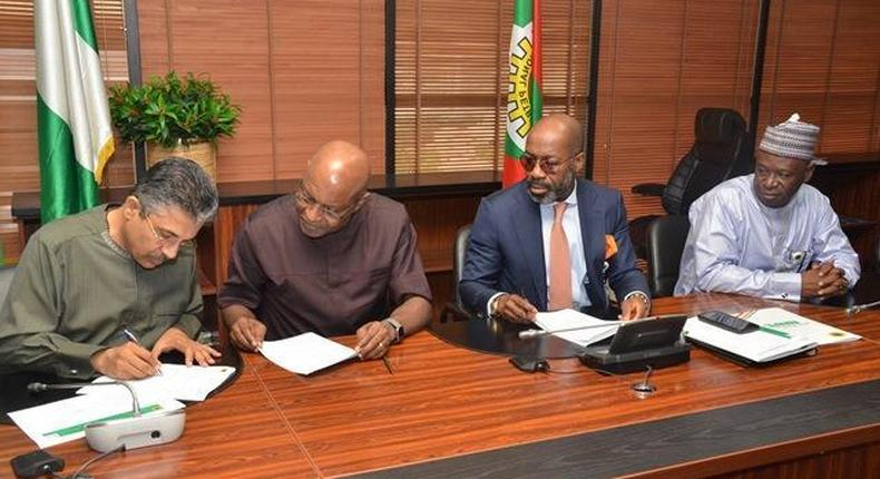 L-R: CEO of SEEPCO, Mr. Deepak Babubhai; Chairman of SEEPCO, Mr. Tony Chukwueke; rep. of NNPC GMD & NNPC COO, Upstream, Mr. Roland Ewubare; & Managing Director of NPDC, Mr. Mansur Sambo, signing Financing & Technical Services Agreement at the NNPC HQ