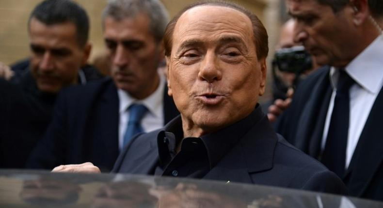 Former Italian prime minister Silvio Berlusconi leaves after voting in a referendum on constitutional reforms in Rome on December 4, 2016