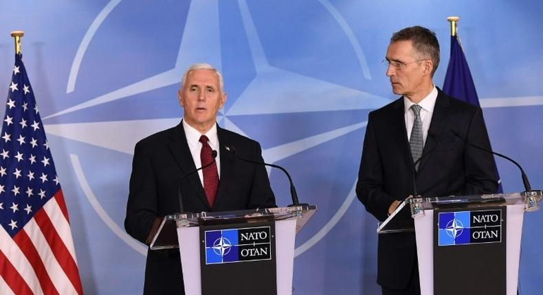 NATO Secretray General Jens Stoltenberg (R) and US Vice-President Mike Pence (L) give a press conference after a meeting at the NATO headquarters in Brussels on February 20, 2017