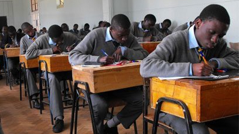 Students writing their KCSE
