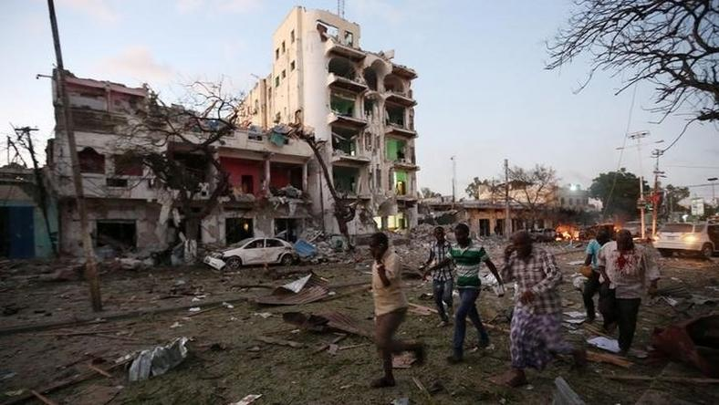 Civilians evacuate from the scene of a suicide car bombing outside Hotel Ambassador on Maka Al Mukaram Road in Somalia's capital Mogadishu, June 1, 2016.