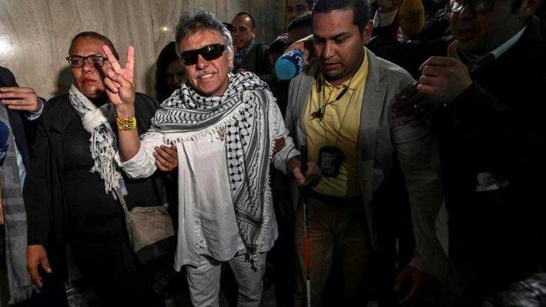Former FARC guerrilla leader Jesus Santrich (C), was sworn in as a Colombian senator June 11, 2019 but has since disappeared after failing to appear in court to face a US extradition request over drug trafficking charges