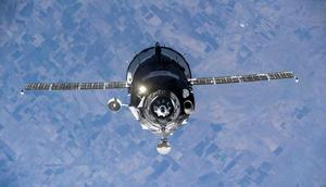 A Soyuz spaceship carrying a Russian film crew and a cosmonaut approaches the International Space Station, October 5, 2021.