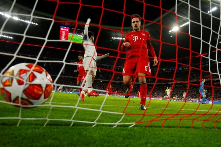 Bayern Munich's German defender Mats Hummels (R) goes to pick the ball out of the net while Mo Salah (C) celebrates Sadio Mane's superb first-half goal for Liverpool.