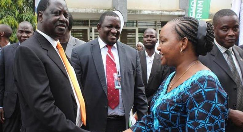 ODM leader Raila Odinga and former devolution CS Ann Waiguru