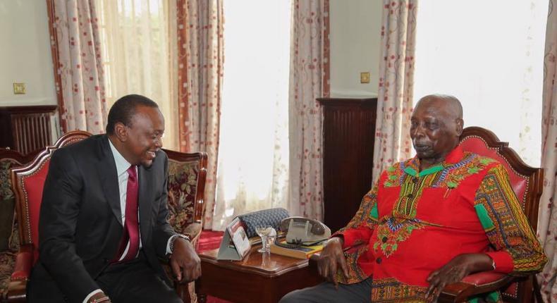 President Uhuru Kenyatta chats with former President Daniel arap Moi when he paid him a courtesy call at his home in Kabarnet Gardens in Nairobi on February 16, 2017.