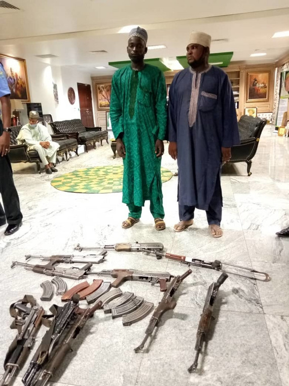 Sale Turwa and Muhammed Sani Maidaji surrendered almost a dozen AK-47 rifles to the Katsina State Government [The Nigerian News]
