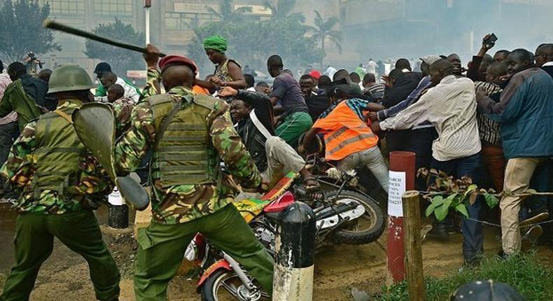 Police beating Kenyans