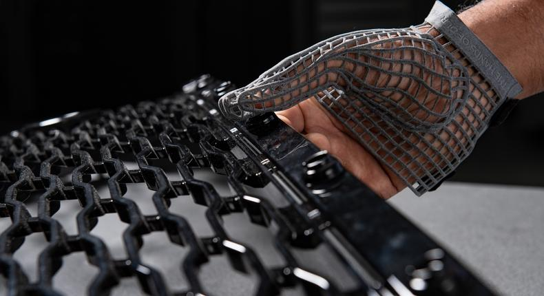 A safe pair of hands:Jaguar Land Rover's is developing a new 3D-printed gloves for workers to reduce injuries.