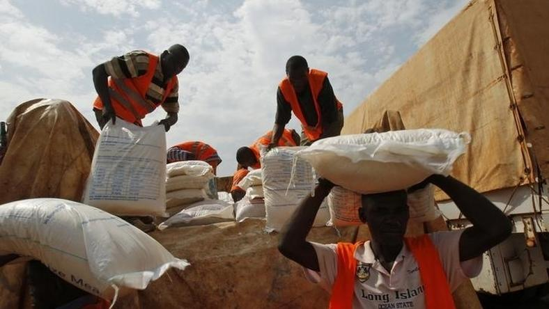 Aid workers unload food to be distributed at a camp for people displaced by the recent unrest, at the Mpoko international airport of Bangui February 12, 2014. REUTERS/Luc Gnago