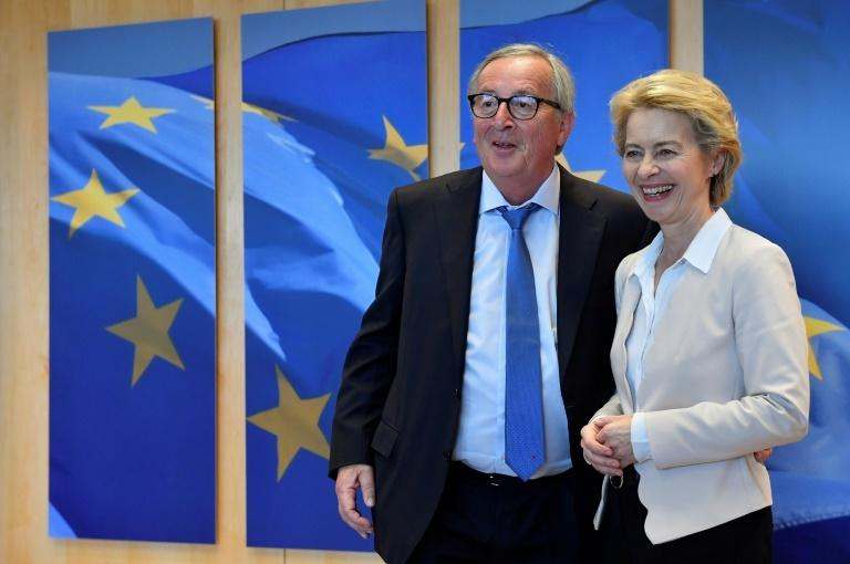 Von der Leyen (R) succeeds outgoing president of the European Commission Jean-Claude Juncker (L)