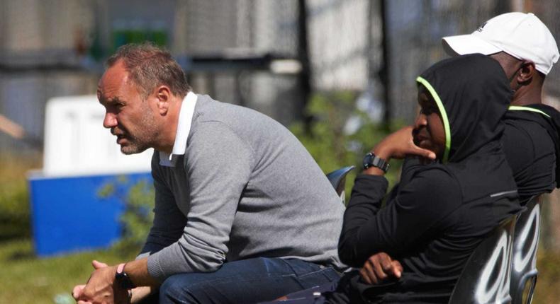 Former Harambee Stars head coach Sebastien Migne (centre) has been fired by South Africa's Premier Soccer League (PSL) side, Marumo Gallants FC.