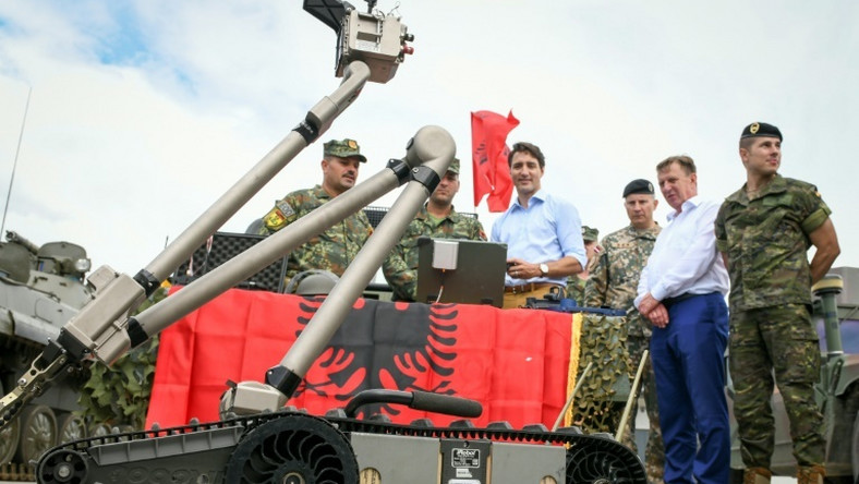 Canadian Prime Minister Justin Trudeau observes a military robot as he meets with Latvian, Canadian and other NATO soldiers in Adazi, Latvia, in July 2018