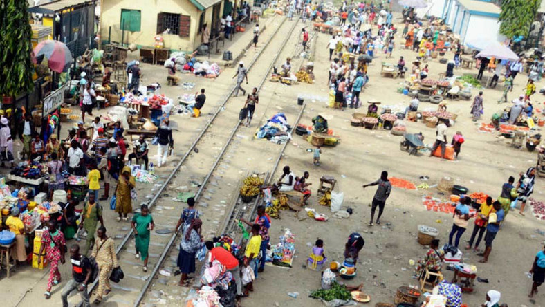 Traders display their wares on rail lines in Lagos (Guardian)