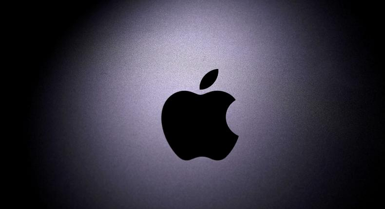 FILE PHOTO: Apple logo is seen on a Macbook in this illustration. Reuters