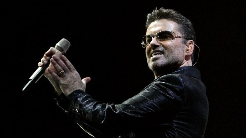 British pop star George Michael, whose publicist said December 25, 2016 had died, performs on stage at the Palau Sant Jordi in Barcelona 23 September 2006