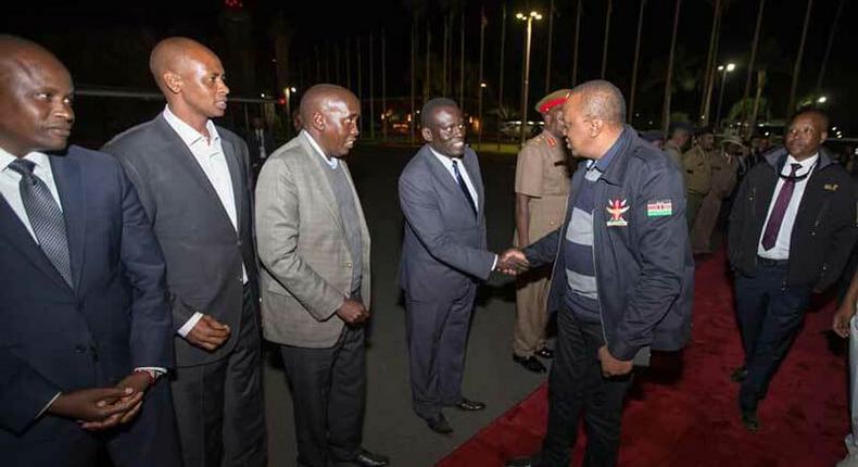 File image of President Uhuru Kenyatta at Jomo Kenyatta International Airport during a past foreign trip