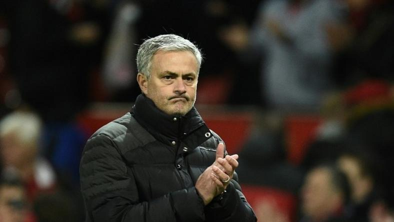 Manchester United's manager Jose Mourinho applauds after the English Premier League football match on December 11, 2016