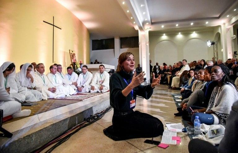 Youths sing in Algeria's northwestern city of Oran on December 7, 2018, ahead of the beatification of seven French monks and 12 other clergymen killed during the Algerian civil war
