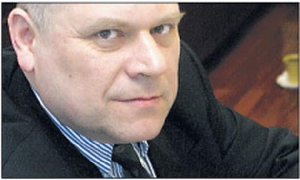 Dr Janusz Fiszer, partner w Kancelarii Prawnej White & Case, docent UW