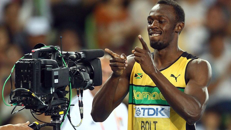 Jeden z bohaterów igrzysk olimpijskich - Usain Bolt i kamera telewizyjna